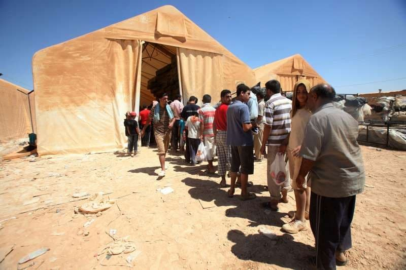 Refugees in Za'atri, Jordan, wait or relief items (UN News Centre 2012)