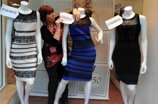 A woman dresses manequins wearing the dress following the image going viral.