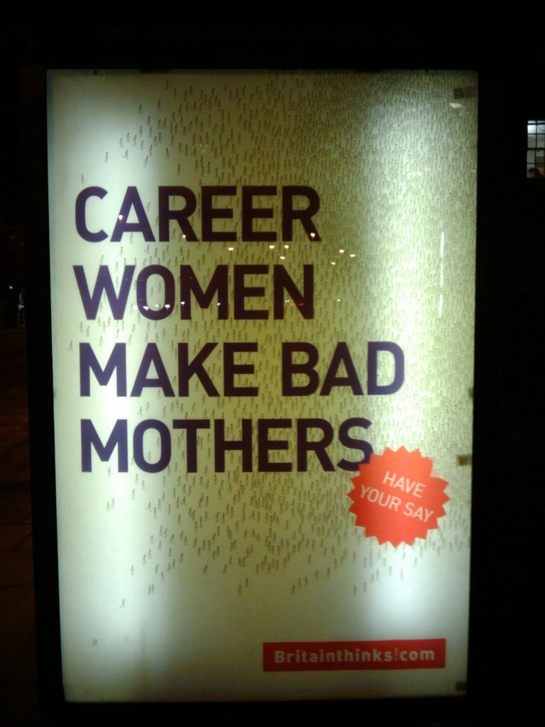 """Photo of a billboard reading """"Career women make bad mothers"""""""