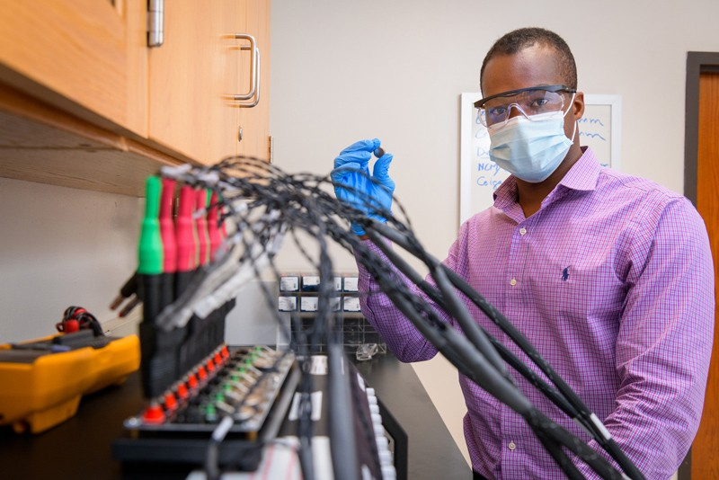 Koffi Pierre Yao, assistant professor of mechanical engineering and UD alumnus, has received a $1 million grant to engineer a next-generation lithium ion battery that could revolutionize the energy industry. In this photo, he conducts electrochemical testing.