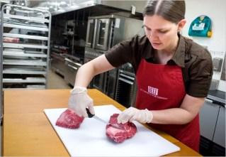 women cutting meat