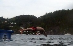 Truls diving into the fjord