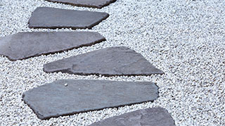 Landscape pavers on a gravel path