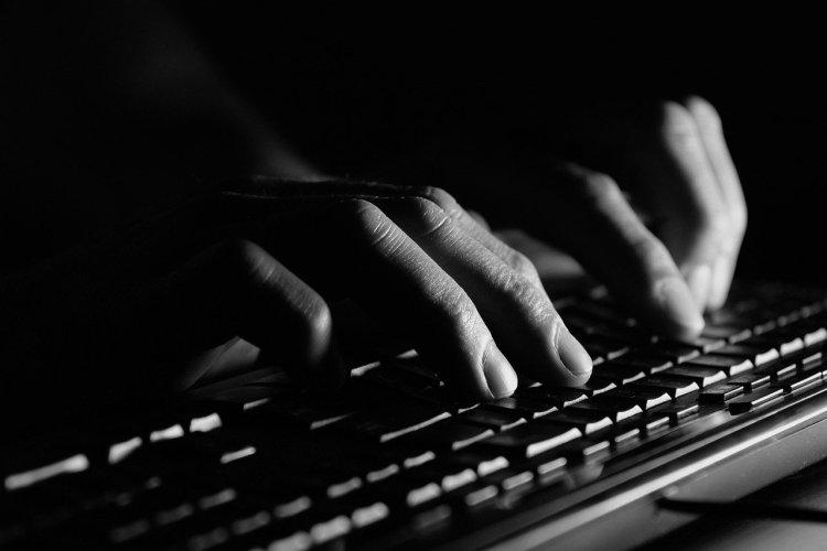 writer typing on keyboard