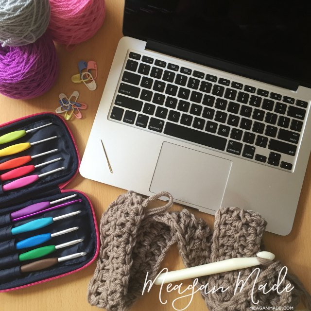 Photo of laptop, crochet hooks, project and yarn