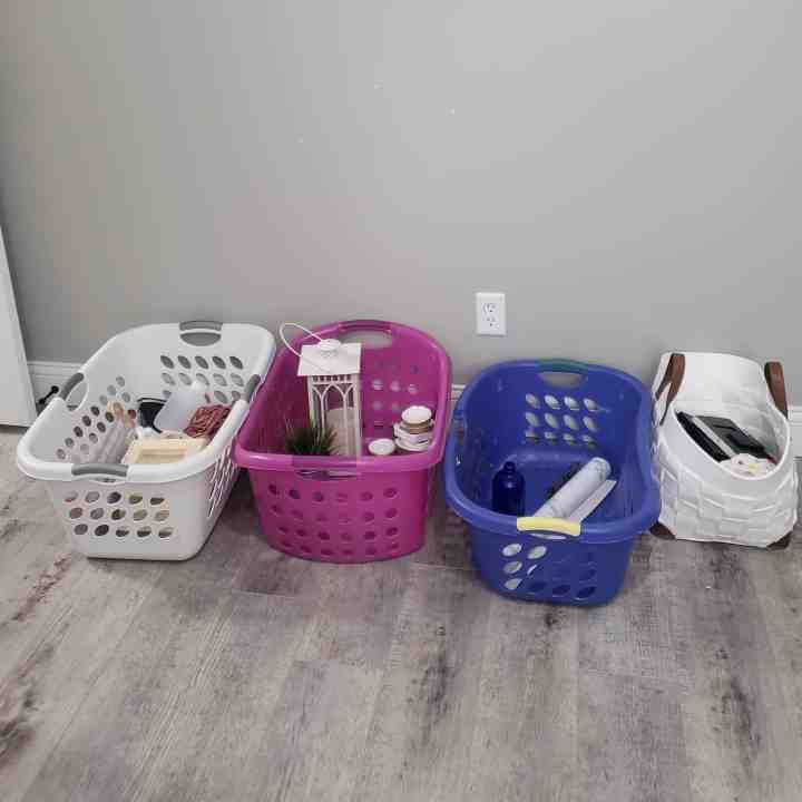 4 baskets used for sorting when you Organize a Messy Room