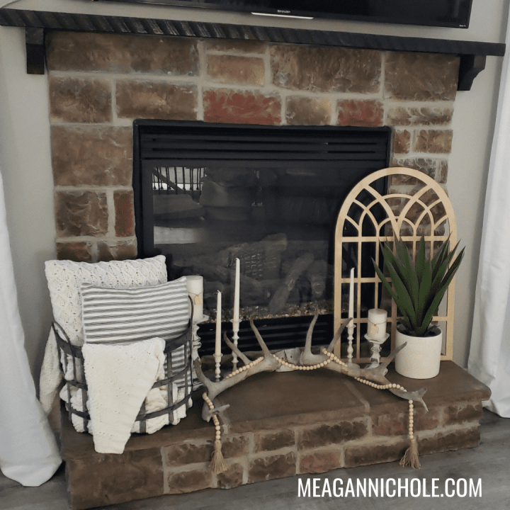 Photo of a short fireplace for a reclaimed barn wood mantle blog tutorial