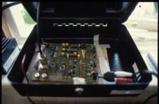 Radio transmitter housed in cash tin, 1999