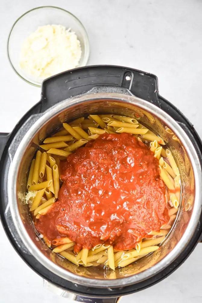 nstant Pot Chicken Parm Pasta sauce on top noodles