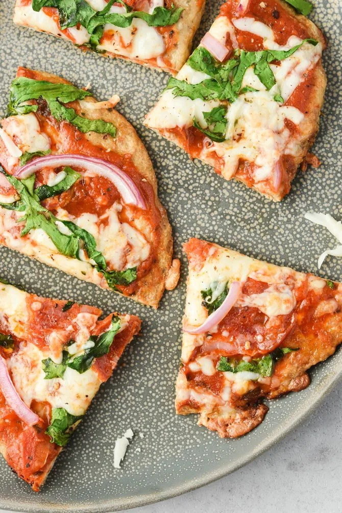 Low carb pizza crusts cooked on a plate