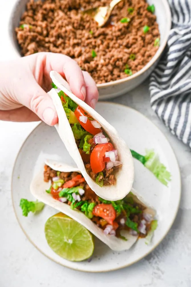 ground beef taco close up in hand