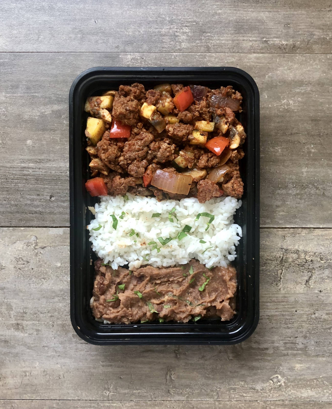 Read more about the article Fire Roasted Tomato Beef with Rice and Refried Beans