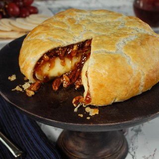 Delicious, gooey baked brie melts inside a shell of golden brown puff pastry. Fig spread adds just the right amount of sweetness and pecans give a little crunch.   Seriously, this recipe is so good, you may just want to put a slice on top of salad and call it dinner!