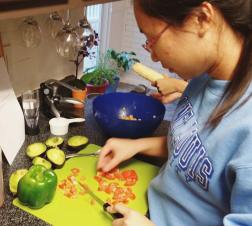 Selina chopping up some veggies four our stuffed avocados.