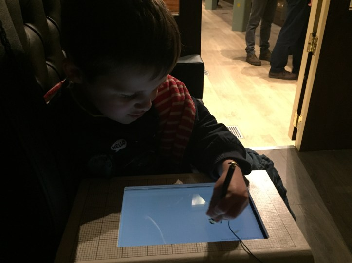b trying to draw a circle in the being brunel museum at ss great britain