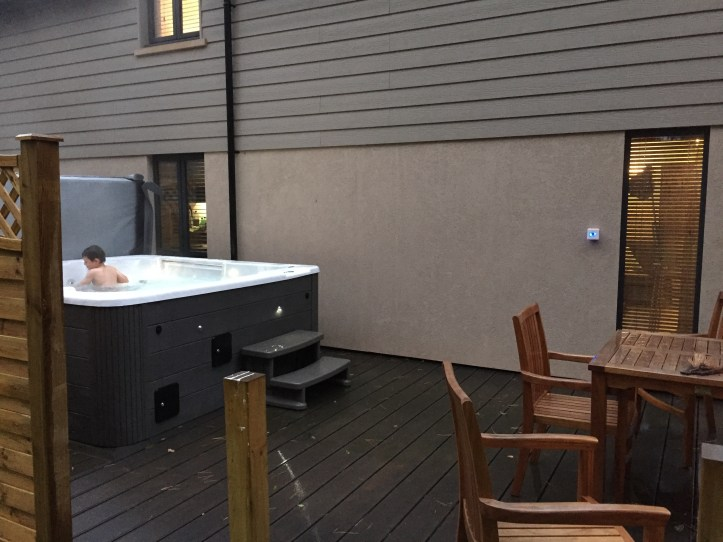 Beyond escapes luxury lodges in Devon hot tub on decking