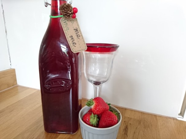 homemade red berry rum - infusing alcohol with berries to make homemade gifts