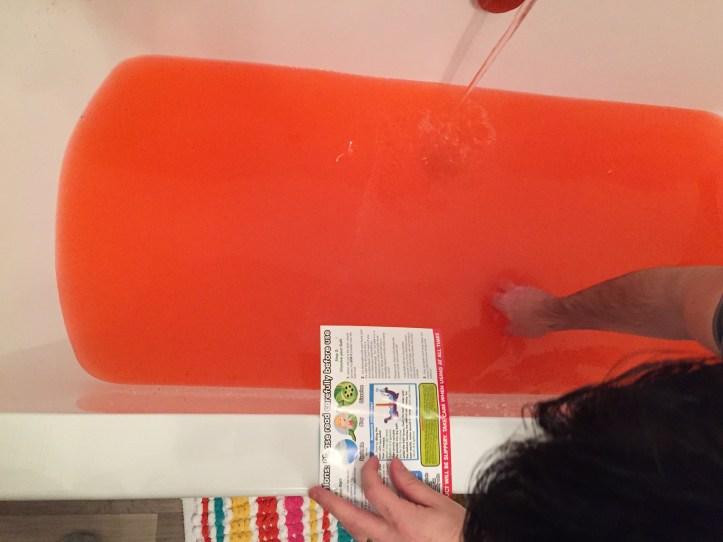 stirring the gelli baff mixture in bath water