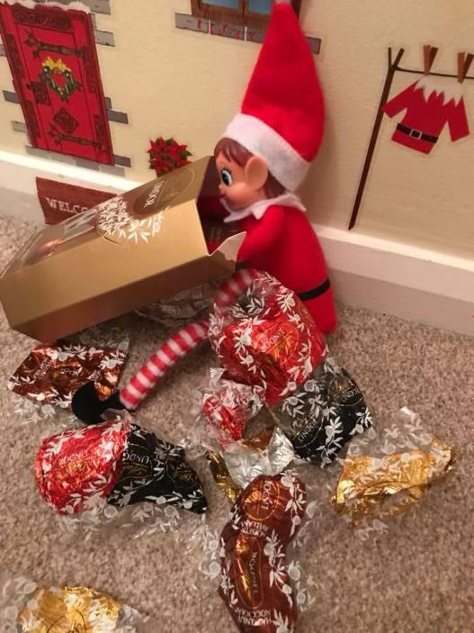 elf stuffing his face with chocolate - elf on the shelf trick