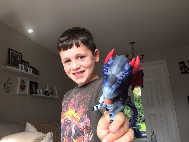 Boy playing with shockwave untamed dragon toy
