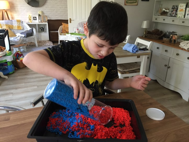 playfoam pluffle from learning resources -boy pouring foam in tray