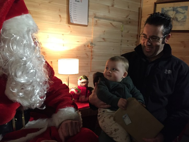bristol zoo garden review - baby looking at father christmas