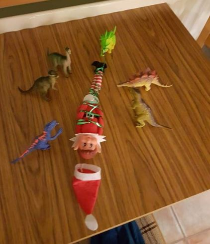 elf tied up by other toys