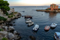 Looking out over a bay in Sicilia with restaurants and fishing boats