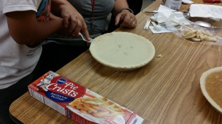 Crimping the edge of the crust