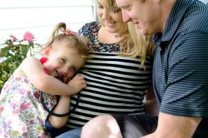 Little girl listening to a baby's heartbeat, Babs Mullinax, me and grace, me & grace, Fort Wayne photographer, photo gifts, lifestyle photography, family photos, ideas for family photos, indoor photography, fun family photographer, long-distance family
