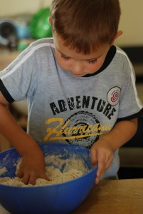 Mixing dough by hand, Babs Mullinax, me and grace, me & grace, Fort Wayne photographer, photo gifts, lifestyle photography, family photos, ideas for family photos, indoor photography, fun family photographer, long-distance family
