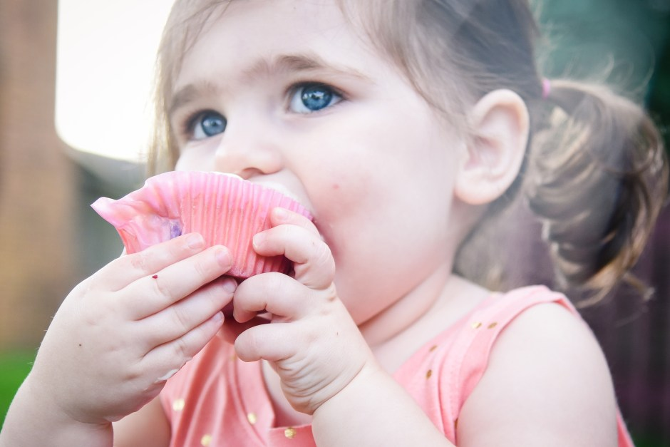 toddler girl eating cupcake, Babs Mullinax, me and grace, me & grace, Fort Wayne photographer, photo gifts, lifestyle photography, family photos, ideas for family photos, indoor photography, fun family photographer, long-distance family