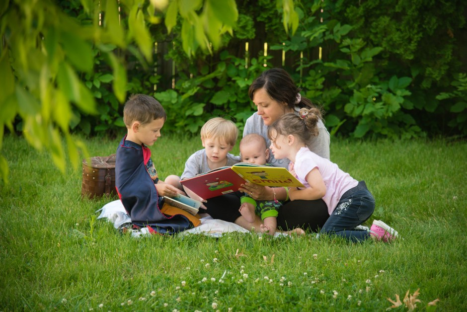 Mom and kids reading a book outdoors, Babs Mullinax, me and grace, me & grace, Fort Wayne photographer, photo gifts, lifestyle photography, family photos, ideas for family photos, indoor photography, fun family photographer, long-distance family