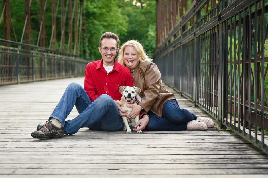 Family with puggle on a bridge, Babs Mullinax, me and grace, me & grace, Avon photographer, Hendricks County photographer, photo gifts, lifestyle photography, family photos, ideas for family photos, indoor photography, fun family photographer, long-distance family