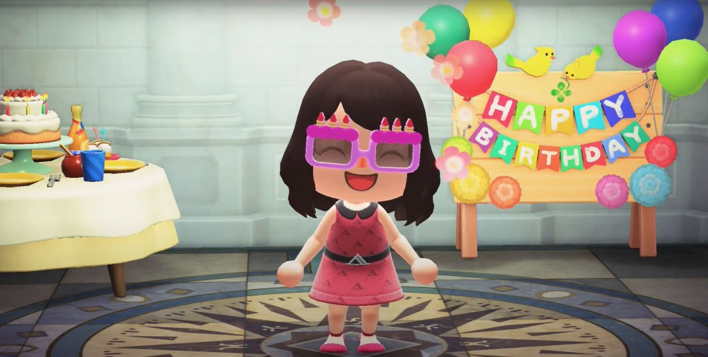 A character is at a birthday party, grinning
