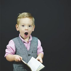 Boy with book discovering meaning