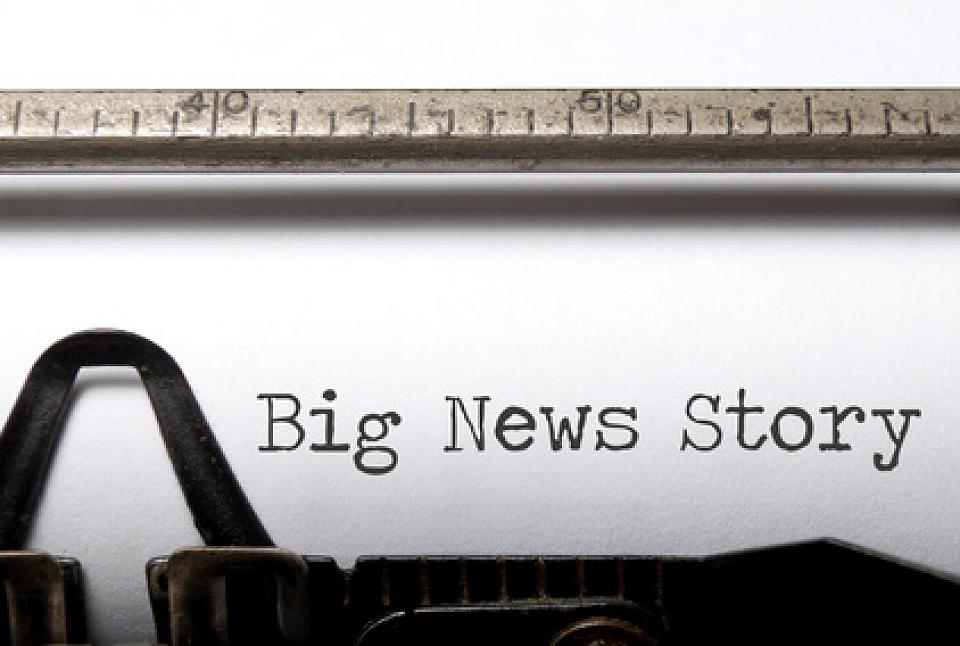 Big news story being typed on typewriter