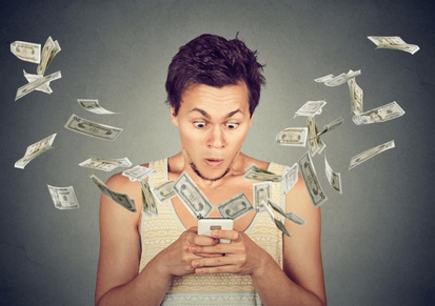 surprised man using smartphone dollar bills flying away from screen