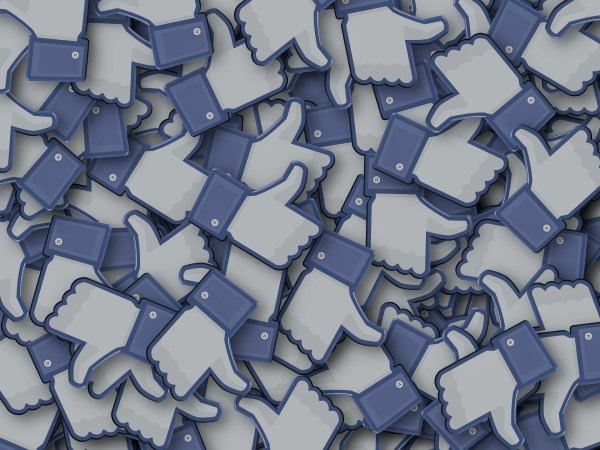 A pile of three dimensional Facebook like icons