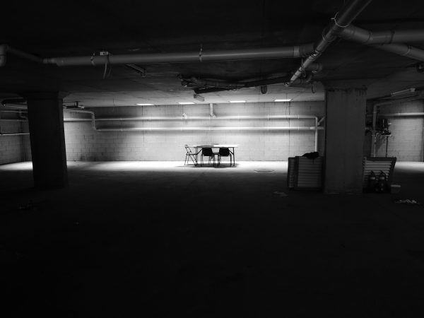 Table and chairs in large empty room
