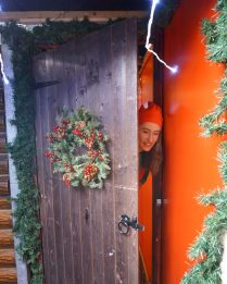 Little Diggers Christmas Grotto elf at the door