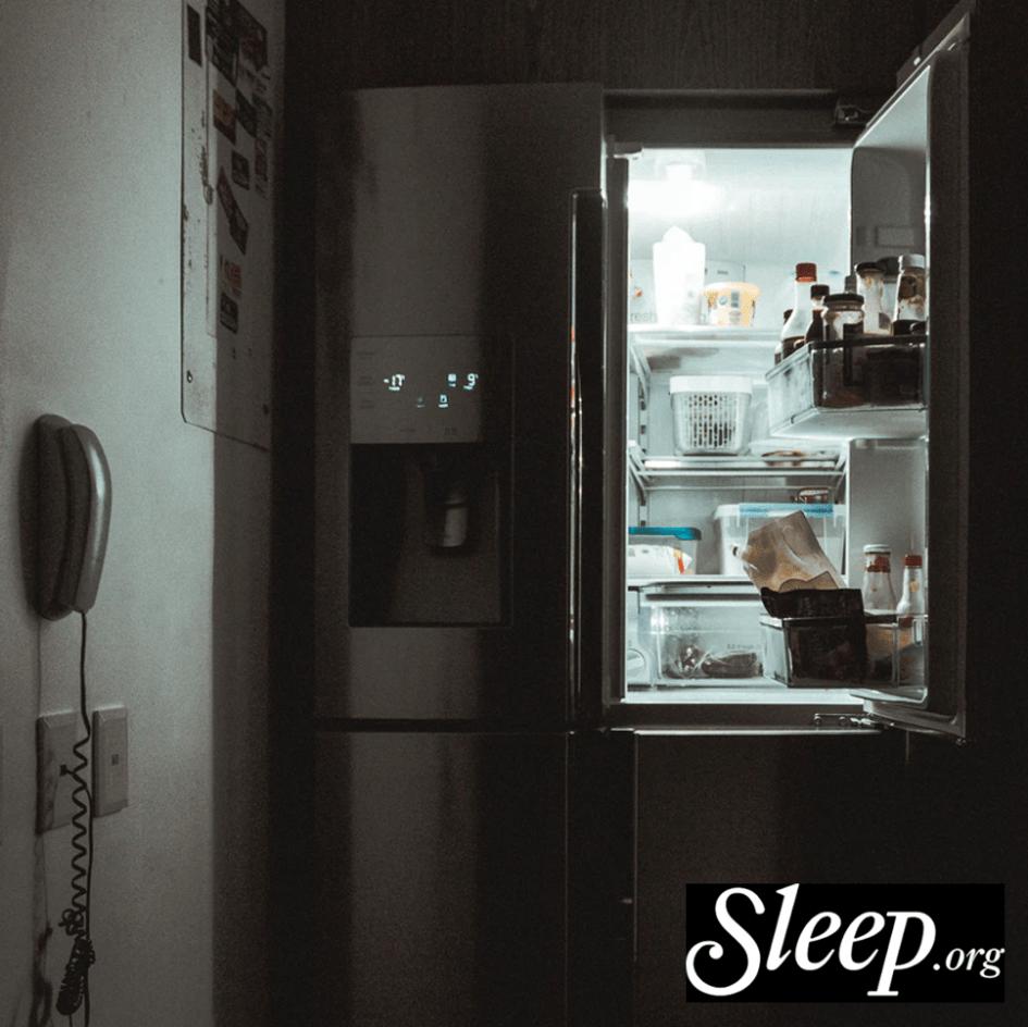 Image of open fridge dark room