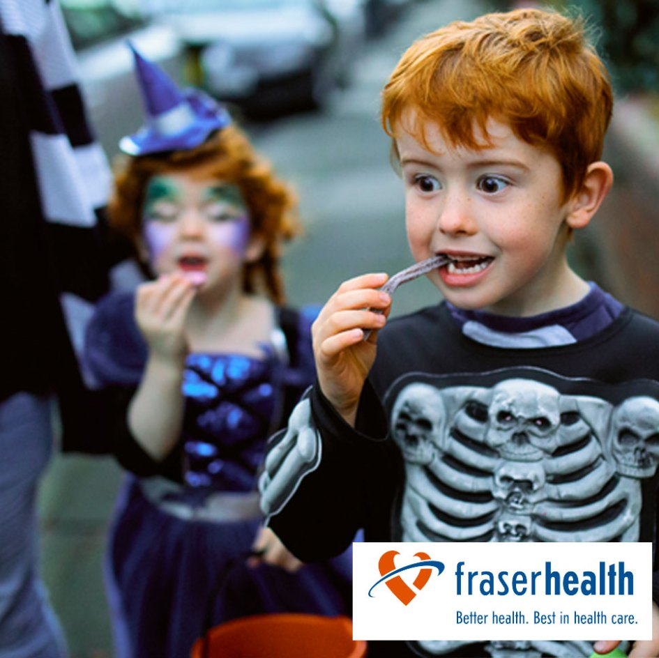 child eating candy in halloween costume