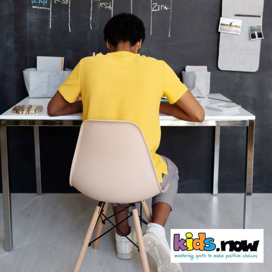 kid sitting at desk