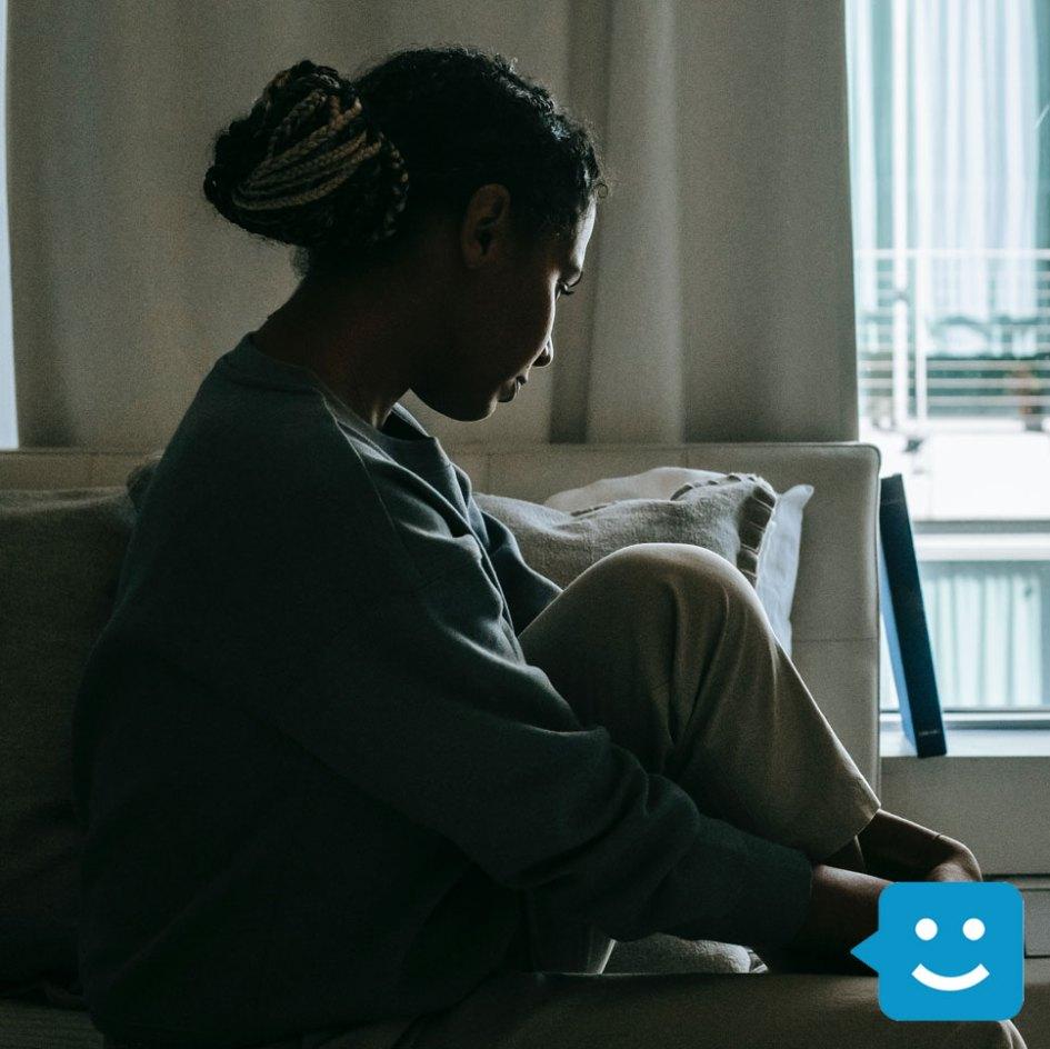 girl sitting in dark room lonely