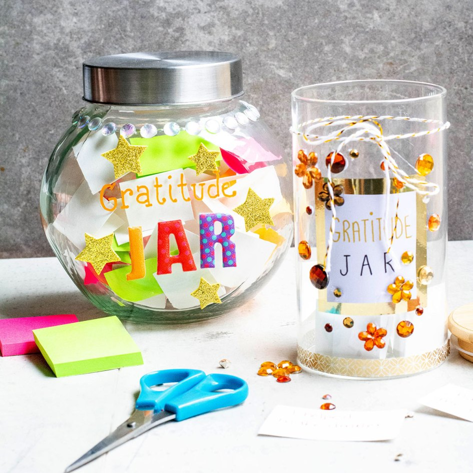 2 gratitude jars on table with scissors