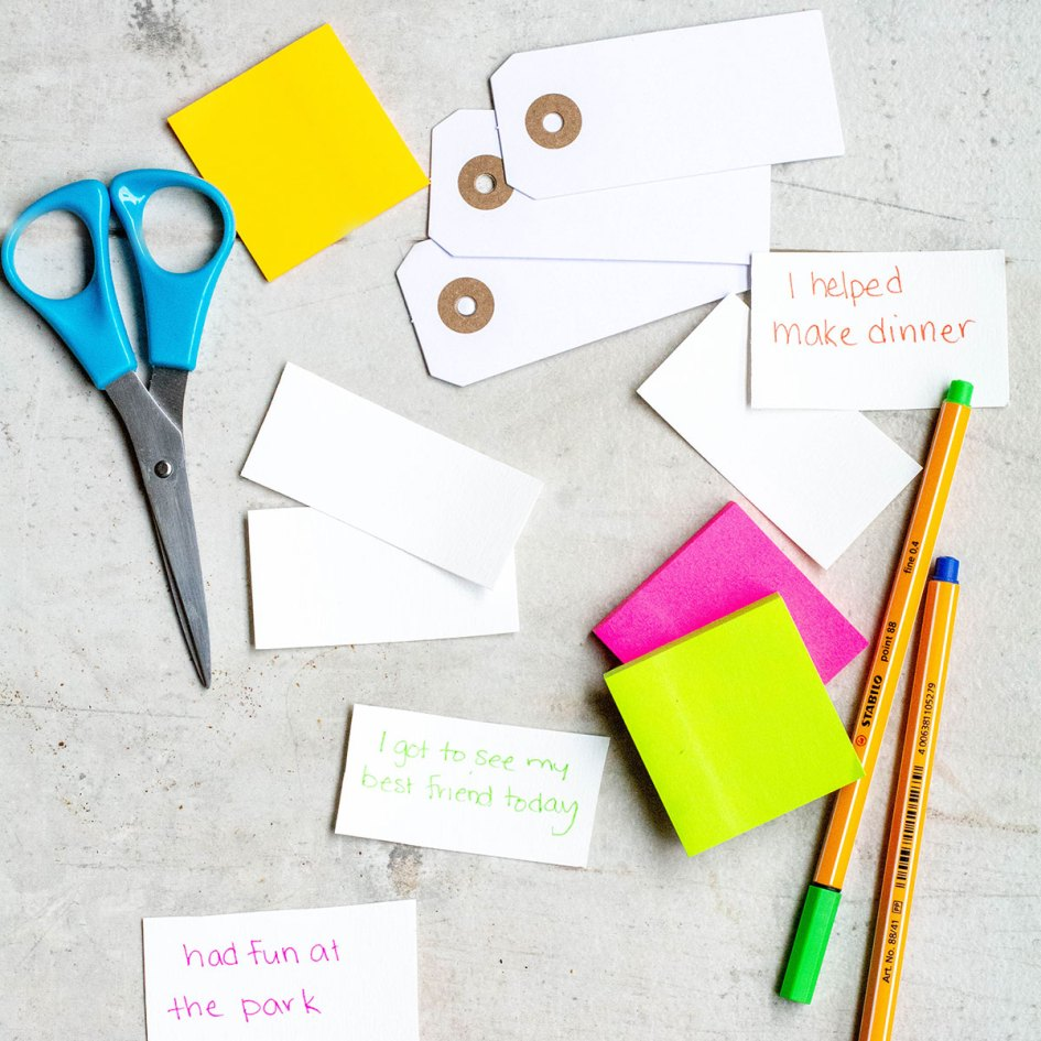 Gratitudes on paper with scissors and colourful markers