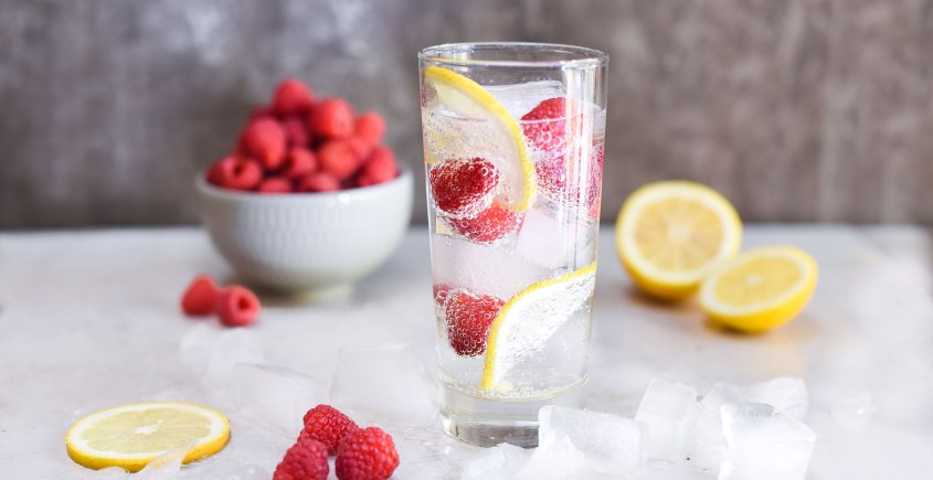 image of fruit spritzer with raspberries and lemon