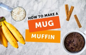 Image of bananas, oats, cinnamon and a mug muffin on marble background