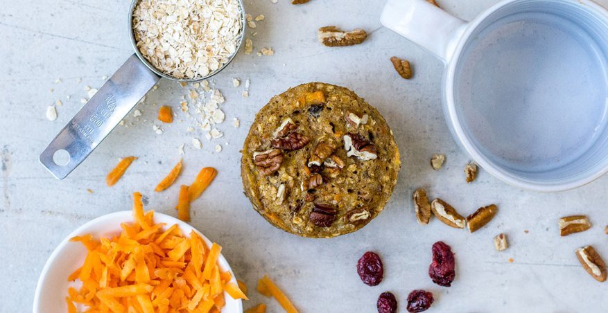 carrot muffin on table with oats and cranberries